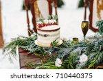 wedding rustic nude cake with... | Shutterstock . vector #710440375