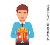 smiling young business man... | Shutterstock .eps vector #710444038