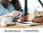 hand of woman using smartphone... | Shutterstock . vector #710449552