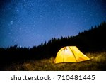 glowing camping tent in the... | Shutterstock . vector #710481445