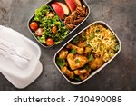 lunch boxes with food ready to... | Shutterstock . vector #710490088