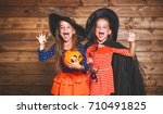 Stock photo laughing funny children sister twins girl in a witch costume in halloween 710491825