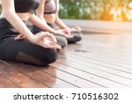 two of woman practicing yoga... | Shutterstock . vector #710516302