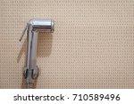 a bidet spray in restroom   Shutterstock . vector #710589496