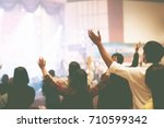 christian worship with raised... | Shutterstock . vector #710599342