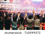 christian worship with raised... | Shutterstock . vector #710599372