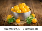 Yellow Tomatoes On An Old...