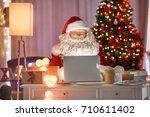 authentic santa claus using... | Shutterstock . vector #710611402
