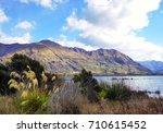 lake wanaka in the morning ... | Shutterstock . vector #710615452