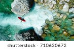some extreme whitewater kayaker ...   Shutterstock . vector #710620672