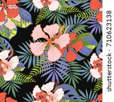 tropical flowers pattern with... | Shutterstock .eps vector #710623138