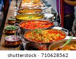 variety of cooked curries on... | Shutterstock . vector #710628562