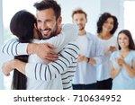 positive happy people hugging... | Shutterstock . vector #710634952
