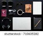 flatlay of gadgets on black... | Shutterstock . vector #710635282