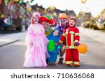 kids and parents on halloween... | Shutterstock . vector #710636068