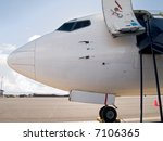 plane parked at the airport | Shutterstock . vector #7106365