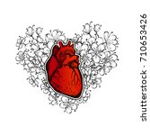 human heart on a floral...   Shutterstock .eps vector #710653426