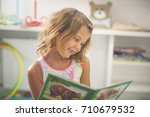 little girl in playground.... | Shutterstock . vector #710679532