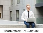 young adult businessman working ... | Shutterstock . vector #710685082