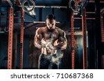 strong muscular man preparing... | Shutterstock . vector #710687368