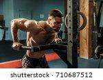 strong muscular man doing push... | Shutterstock . vector #710687512