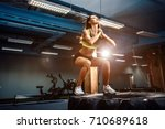 fit young woman jumping on tire ... | Shutterstock . vector #710689618