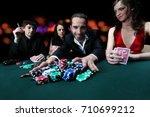 poker players sitting around a... | Shutterstock . vector #710699212