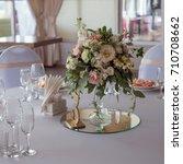 wedding decor. flowers in the...   Shutterstock . vector #710708662