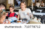 nice parents with two kids... | Shutterstock . vector #710778712