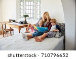 mother with children sitting on ... | Shutterstock . vector #710796652