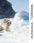 Small photo of Rough sea and furious waves smack into the rocks at the beach of Cala Goloritzè, Sardinia, Italy.