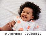 parent tickling laughing baby... | Shutterstock . vector #710805592