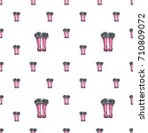 vector pink wellies with blue... | Shutterstock .eps vector #710809072