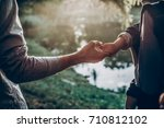 father and little son holding...   Shutterstock . vector #710812102