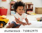 happy baby girl playing with... | Shutterstock . vector #710812975