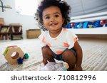 cute baby girl having fun in... | Shutterstock . vector #710812996