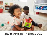 baby boy and girl playing with... | Shutterstock . vector #710813002