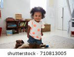 portrait of happy baby girl... | Shutterstock . vector #710813005