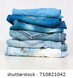 stack of blue jeans on white... | Shutterstock . vector #710821042
