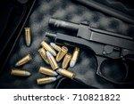 Black Guns And Boxes At The...