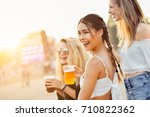 friends drinking beer and... | Shutterstock . vector #710822362