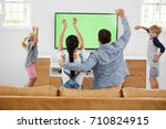 family watching sports on... | Shutterstock . vector #710824915