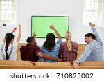 group of young friends watching ... | Shutterstock . vector #710825002