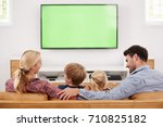 rear view of family sitting on... | Shutterstock . vector #710825182