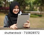 muslim lady working on smiling | Shutterstock . vector #710828572