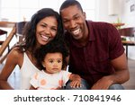 portrait of family with baby...   Shutterstock . vector #710841946