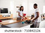 couple preparing meal together...   Shutterstock . vector #710842126