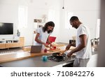 couple preparing meal together... | Shutterstock . vector #710842276