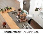 overhead view of couple looking ... | Shutterstock . vector #710844826