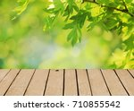 top of wooden table on nature... | Shutterstock . vector #710855542
